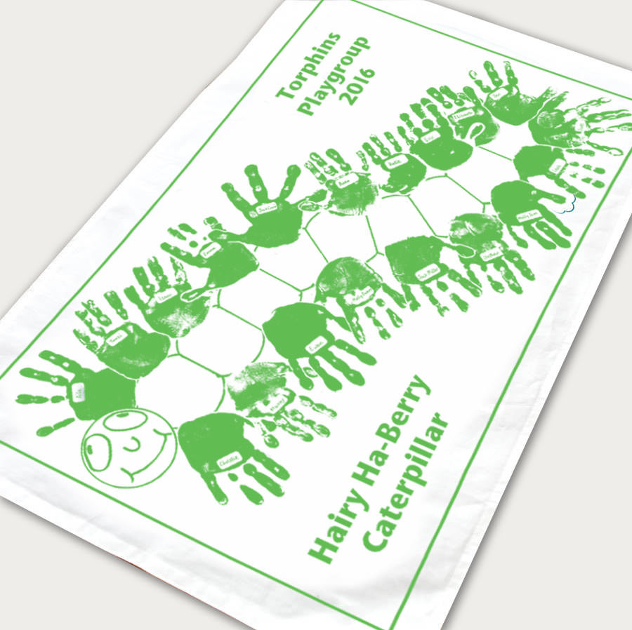 Example green hand print caterpillar tea towel
