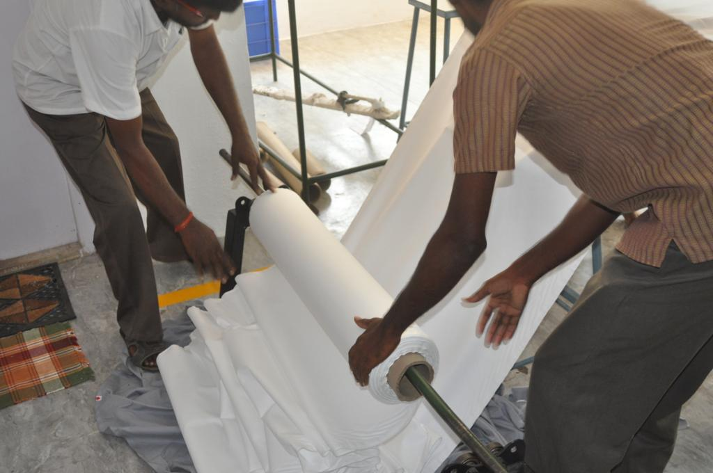 Our cloth being rolled