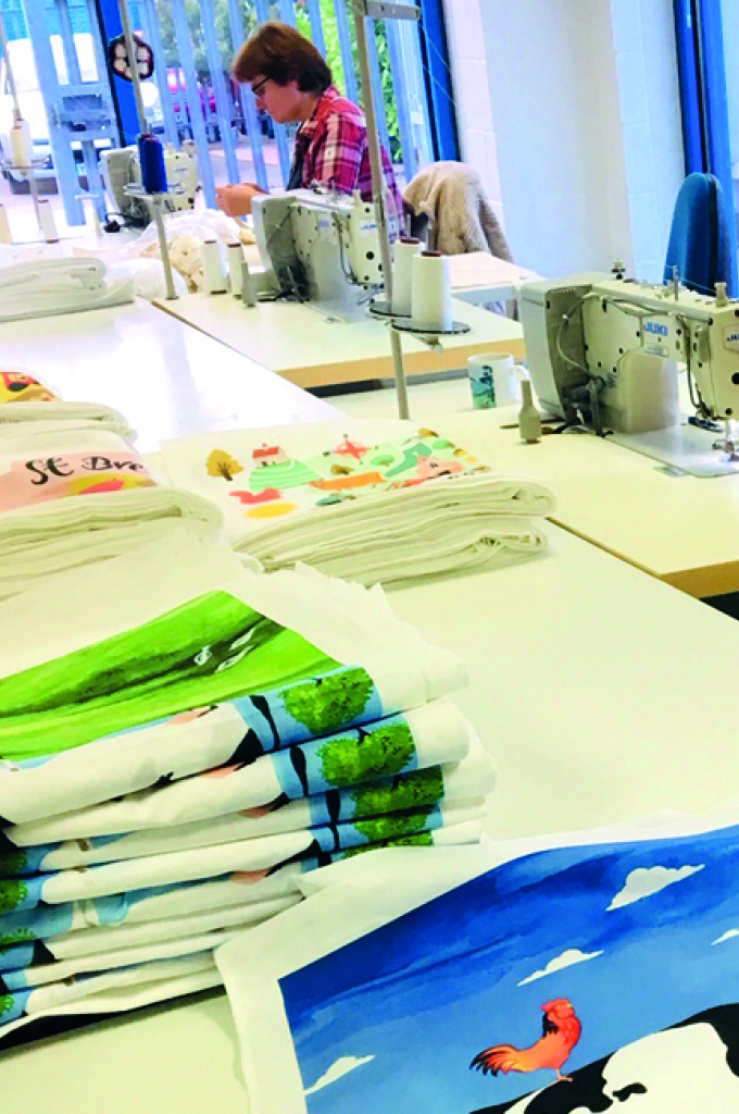 Our experienced team sewing the cloth